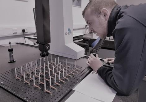 Operator using a cmm machine to measure aerospace parts