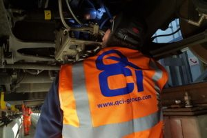 QCI inspection services - qci inspector following procedure of check under body of a rail car at a worldwide depot following all customer requirements