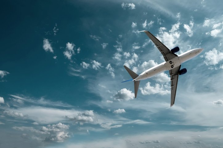 Aerospace plane flying in sky with qci operators onboard inspecting