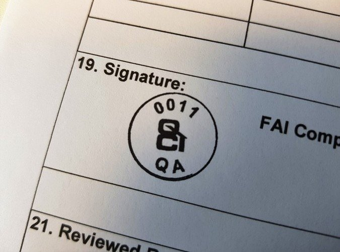 A plain document displaying a QCI Inspection FAI approval stamp after CMM inspection has been completed
