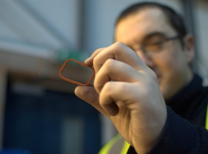 quality inspection services - qci inspector closely inspecting the quality of an aerospace rubber seal