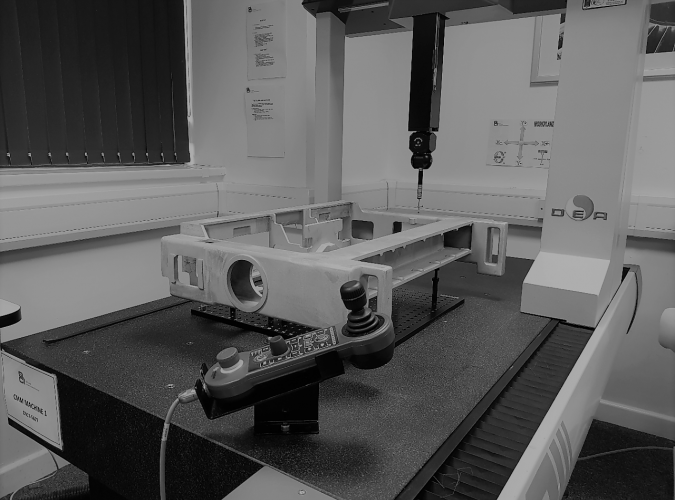 An image showing a large casting being measured by a CMM machine