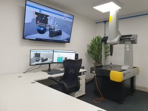 QCI CMM training room with large tv display, and dea CMM machine