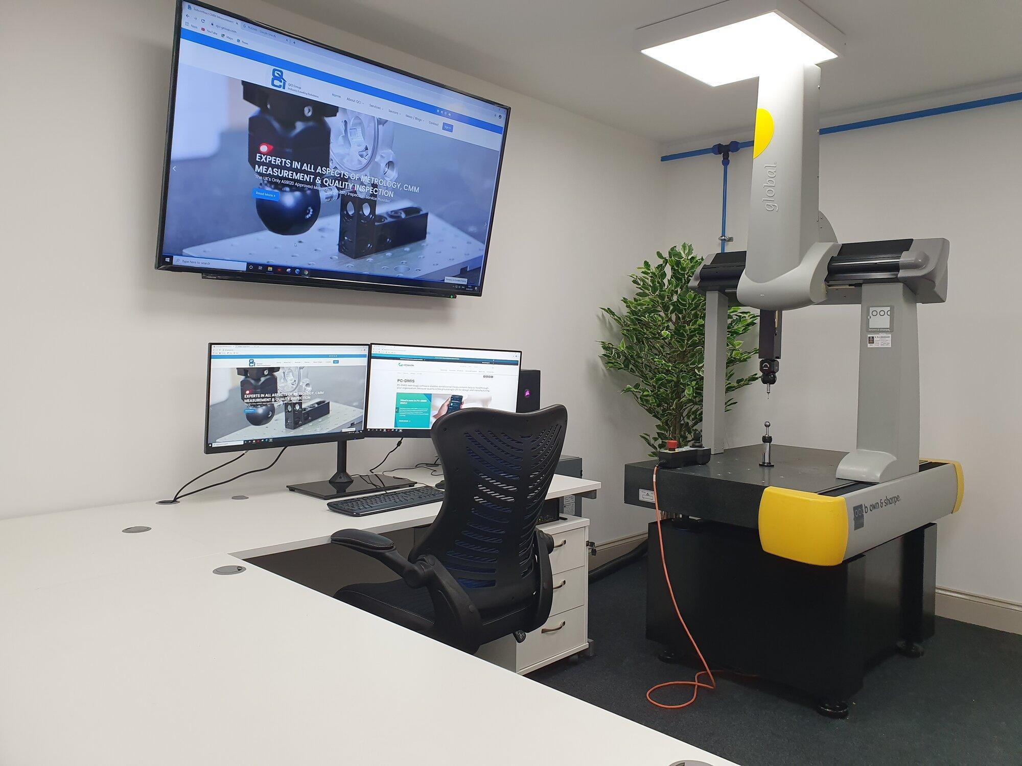 QCI CMM training room with large tv display, and dea CMM machine